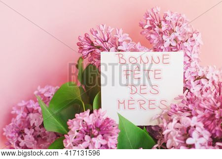 Beautiful Spring Bouquet Of Lilac Flowers And Gift Cardboard White Card With The Inscription Happy M
