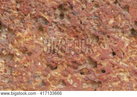 Blur Of Red Laterite Brick Wall Porous And Fine-grained Background Pattern
