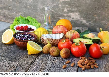 Healthy Food Of Vegetable Origin On Old Wooden Background. Concept Of Proper Nutrition.