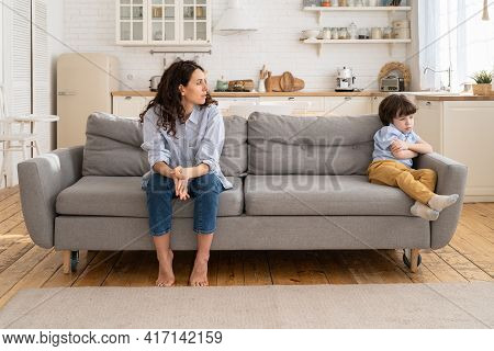 Disappointed Female After Discord And Argument With Naughty Son Look At Boy With Tears In Eyes. Youn