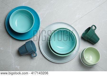 Set Of Elegant Dishware On Light Grey Marble Table, Flat Lay