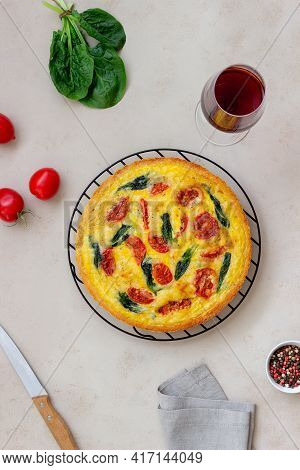Quiche Or Pie With Tomatoes, Spinach And Cheese. Healthy Eating. Vegetarian Food. French Cuisine.