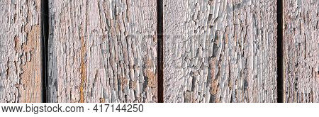 Grunge Background From Weathered Light Wood Plank. Cracks In Old Pink Paint. Wallpaper Or Background