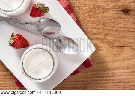 Panna Cotta Dessert With Strawberry On Wooden Table.top View. Copy Space