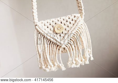 Handmade White Macrame Bag On The Linen Background, Eco Friendly. Hobby Knitting Handmade Macrame. M