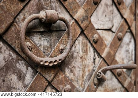 Antique Round Iron Handle On An Old Metal Rusty Gate