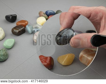 Exploring Semi-precious Stones With A Loupe. Colored Gemstones Under The Magnifying Glass