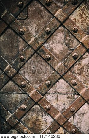 Old Medieval Metal Gate Background. Fragment Of The Old Iron Door.