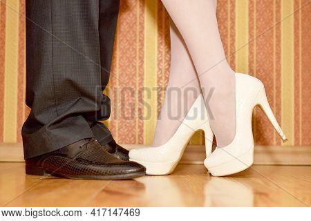 The Legs Of A Couple In Love Met A Guy And A Girl Shod In Shoes