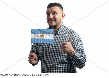 White Guy Holding A Flag Of Argentina And Shows The Class By Hand Isolated On A White Background. Li