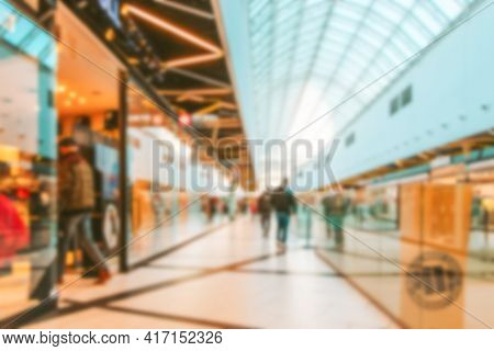 Retail Shoppers Blurred Background. Interior Of Retail Centre Store In Soft Focus. People Shopping I