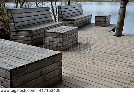 Floating Walkway Made Of Wood Planks. Narrow Curved Leads Above The Lake Water. Has No Railings. Mor