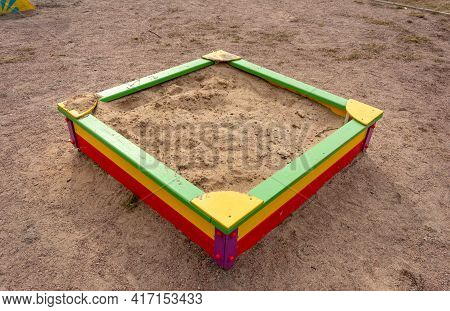 An Empty Children's Sandbox In The Courtyard Of High-rise Buildings.
