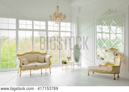Belarus, Minsk - May 05, 2020: Furniture In A Light, Elegant White Luxurious Interior With Large Gla
