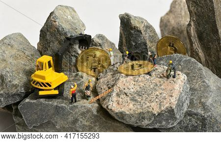 Galati, Romania - April 13, 2021 Construction Site With Miniature Workers Cryptocurrency Mining Bitc
