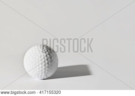 Abstract Golf Ball With Square Shadow On White Table
