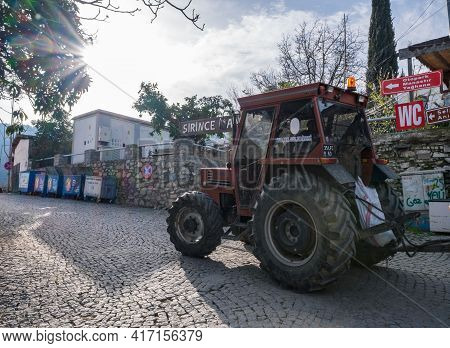 Sirince, Izmir, Turkey - 03.08.2021: Local Tractor Moving On Entrance Of Sirince Village And Shining