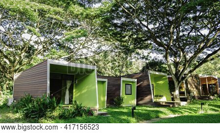 Modern Cottage In Green Nature Trees, Green Field Garden With Sun Light In The Morning