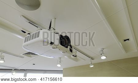 Video Projector On Ceiling, Business Conference Interior Or Lecture In Office