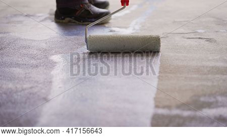 Priming Concrete Floor Before Laying Tiles On It, The Final Preparatory Stage For Strengthening The