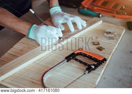 Diy Woodworking, Carpenter Measuring Wood, Close Up.