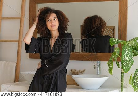 Sensual Portrait Of Young Woman. Young Attractive Woman Standing In Front Of Bathroom Mirror. Skinca