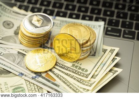 Ethereum Coins And Bitcoin On A Dollars And On A Laptop. Trading On The Cryptocurrency Exchange. Cry