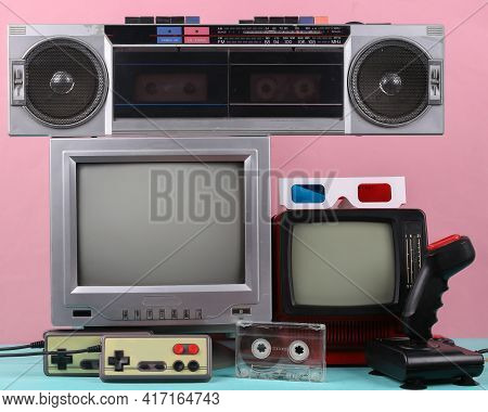 Retro Portable Mini Tvs, Record Player, Joystick, Gamepads, Audio Cassette On Pink Background. Attri