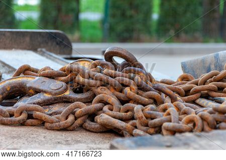 Old Rusty Chain. Rusty Chains On Blurred Background. Weathered Chain Links.