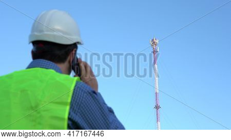 Cellular Engineer Next To The Mast. Cell Telecommunications