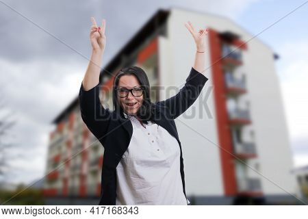 Cheerful Corporate Business Woman Making Double Peace Or Victory Gesture Wearing Smart Casual Suit A