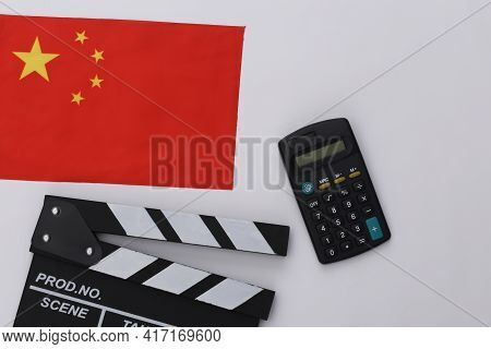 Movie Clapper Board And Calculator, China Flag On White Background. Cinema Fees. Filmmaking, Movie P
