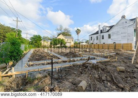 New Orleans, La - April 7: Freshly Poured Foundation For New House On Corner Lot In Old Uptown Neigh