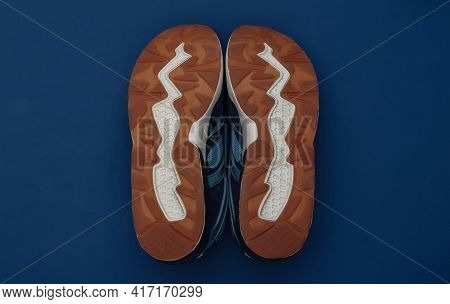 Running Shoes Sole On Classic Blue Background. Healthy Lifestyle, Fitness Training. Color 2020. Top