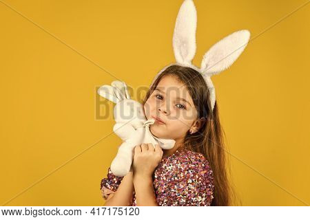 Happy Childhood. Cute Child Play With Toy. Toy Shop Concept. Girl In Funny Rabbit Ears. Happy Easter