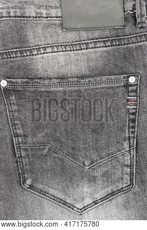 Pocket Of Jeans, Close Up Of Details Of Jeans Trousers With Black  Stitches. Black Seam On Black Jea