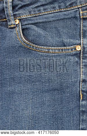 Pocket Of Jeans,  Close Up Of Details Of Jeans Trousers With Orange Stitches. Orange Seam On Jeans.