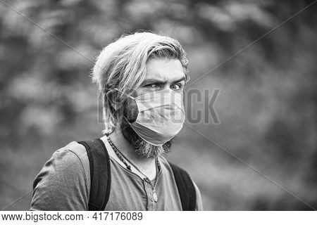 Avoid Infection Wearing Mask. Male Enjoy Nature Walking. Man Wearing The Face Mask Due To Air Pollut