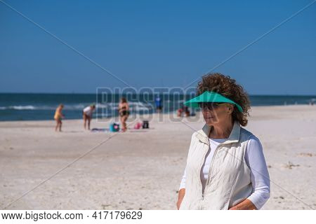 Gulf Shores, Al - March 29: Senior Woman Walks The Beach Along The Gulf Of Mexico On March 29, 2021