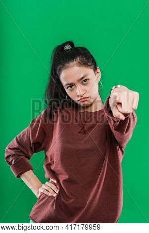 Young Asian Woman Pointing At The Camera While Expression Pissed Off The Face