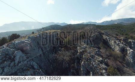 Rocky Ridge On Background Of Mountain Landscape On Sunny Day. Shot. Small Rocky Mountain On Backgrou