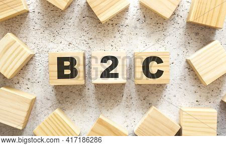 The Word B2c Consists Of Wooden Cubes With Letters, Top View On A Light Background.