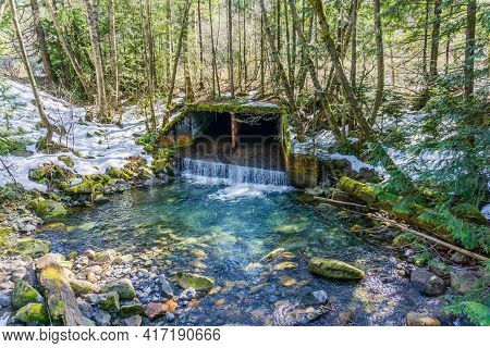 Water Flows Out Of A Culvert Near Denny Creek In Washington State.
