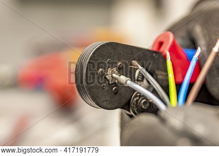 Wire Crimping Tool. Close-up Crimper. A Man Holds A Wire Crimper. Equipment For The Electrician. Cop