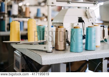 Thread Sewing Overlock. Modern Overlock Sewing Machine. Thread Serger. Sewing Factory. Clothing Indu