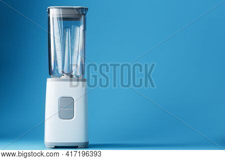Electric Blender With An Empty Cup On A Blue Background.
