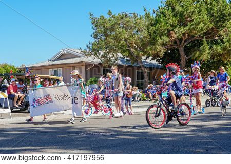 Young Kids With American Flag Parading At The 4th Of July Independence Day Parade In Rancho Bernardo