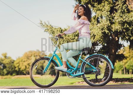 Full Length Profile Side Of Young Attractive Afro Woman Happy Positive Smile Look Ahead Ride Bicycle