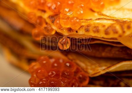 Traditional Russian Pancakes With Red Salmon Caviar. Shrovetide Week Of The Meeting Of Spring. Seein