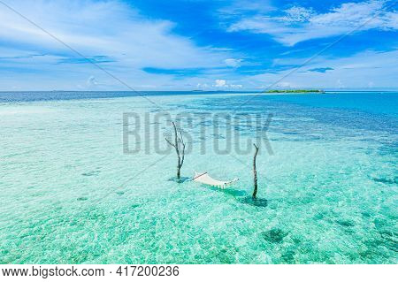Tropical Ocean Lagoon Paradise As Summer Landscape With Beach Swing Or Hammock, Calm Sea For Serene